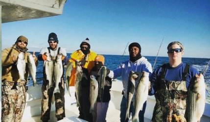 Showing off fish caught with Chuck's Charters